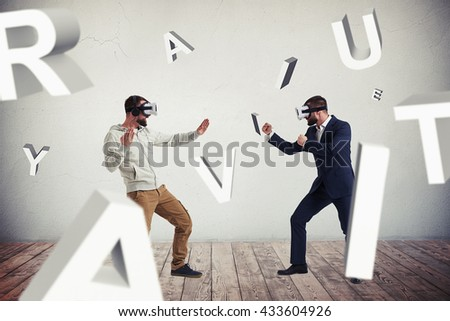 Two men, one in casual clothes, another in dark business suit, are wearing virtual reality glasses and standing in fighting poses ready to start their combat surrounded by flying letters - stock photo