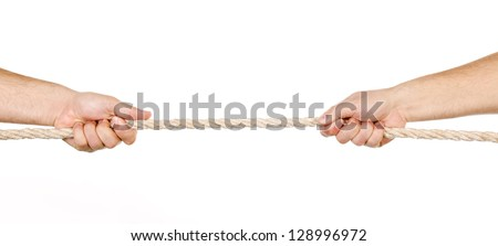 Two men pulling a rope in opposite directions isolated on white - stock photo