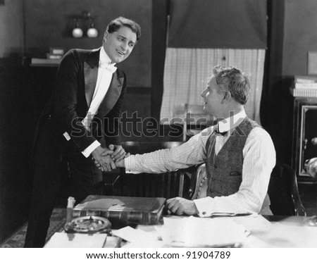 Two men shaking hands - stock photo