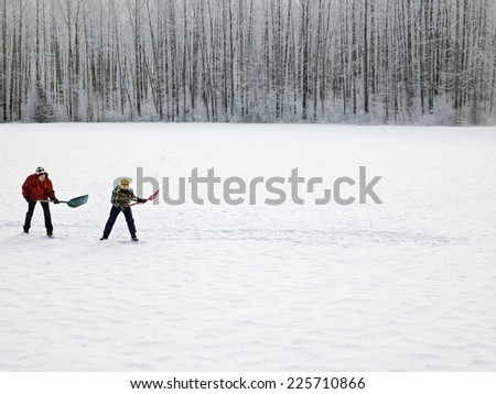 Two Men Shoveling Snow