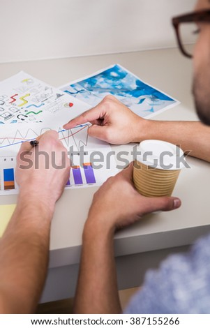Two men showing graph in office