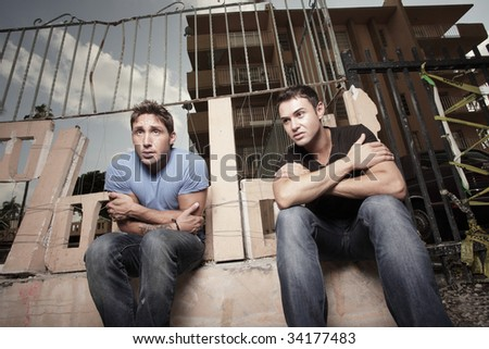 Two men sitting in the cold - stock photo