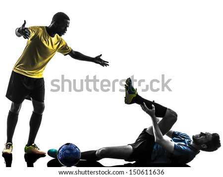 two men soccer player playing football competition complaining foul in silhouette on white background - stock photo