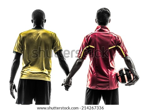 two men soccer player playing football competition hand in hand in silhouette on white background - stock photo