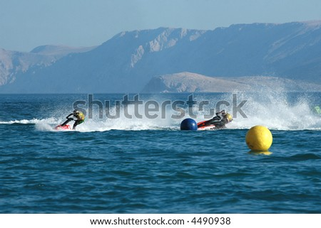 Two men speeding on jet ski