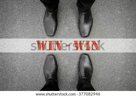 Two men standing on both side of the win-win line. Represent that no one has to lose in business, both can win. - stock photo