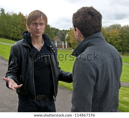 Two men talking in the park