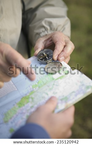 Two Men with Compass and Map - stock photo