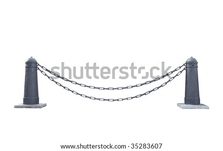 Two metal bollards and chain between them - stock photo