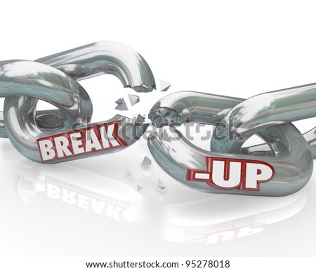 Two metal chain links broken with the words Break-Up to represent a separation or divorce, or the ending of a relationship or partnership - stock photo