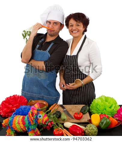 Two Mexican chefs preparing a meal for a Cinco de Mayo fiesta - stock photo