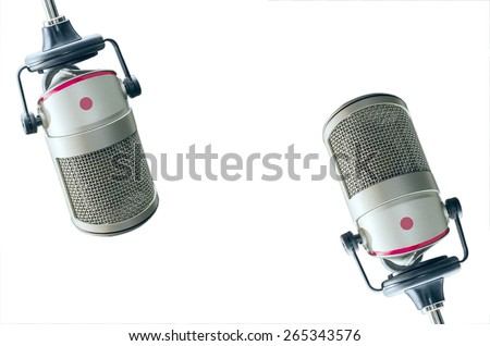 two microphones on a white background - stock photo