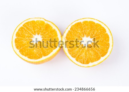 Two middle Orange fruit - stock photo