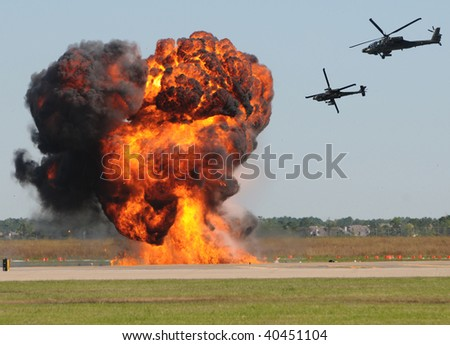 Two military helicopter attacking target on the ground - stock photo