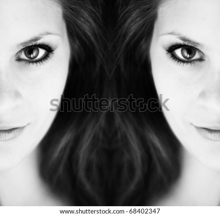 Two mirror views of half of one young womans face in black and white. - stock photo