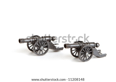 two models of cannon on white - stock photo