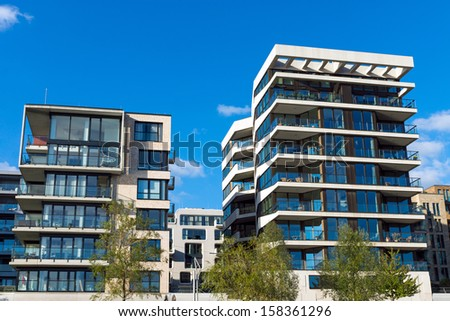 Two modern apartment houses - stock photo