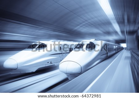 two modern high speed train with motion blur - stock photo