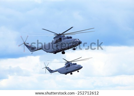 Two modern russian military transport helicopters in flight - stock photo