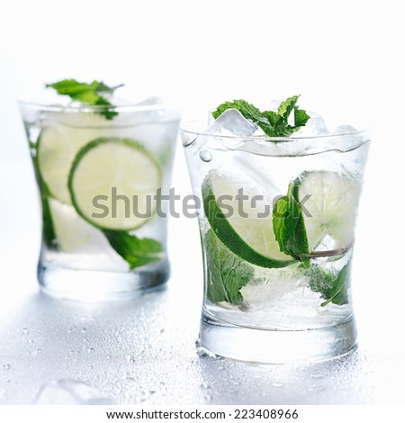two mojito cocktails on background - stock photo