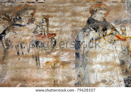 two monks on the wall of monastery San Fransisco in Antigua Guatemala - stock photo
