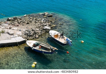 Two motor boats on a beautiful, clean blue sea