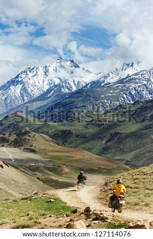 Two motorbike tourist traveller hiker in india Himalayas mountains - stock photo