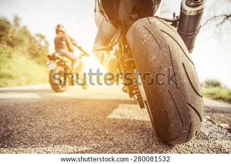 two motorcycles on the hills riding. friends having fun in the weekend with an excursion on their motorcycles - stock photo