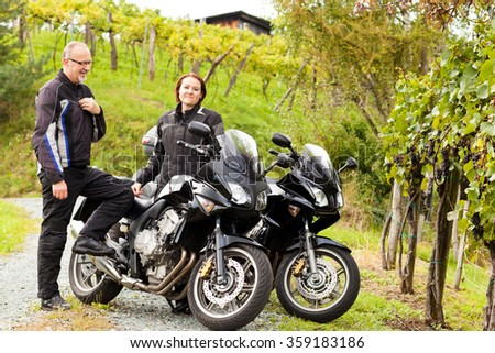 Two motorcyclists in an idyllic countryside