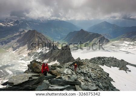 Two mountaineers on the ridge climbing Grossglockner, Austria - stock photo
