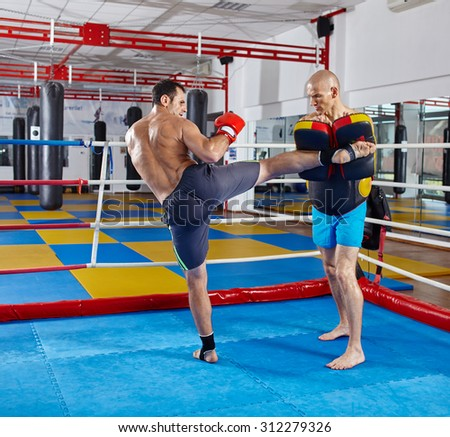 Two muay thai fighters in a sparring match in the ring - stock photo