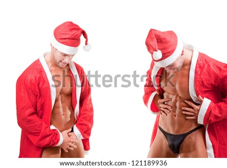 two muscular santa claus over white - stock photo