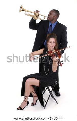 Two musicians relax backstage while preparing their instruments for the concert. - stock photo