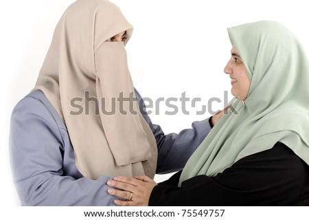 Two muslim women - stock photo