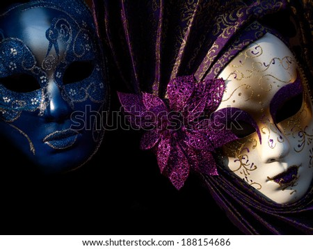 two mysterious Venetian mask on a black background - stock photo