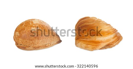 Two Neapolitan Sfogliatelle, riccia and frolla, isolated on white background