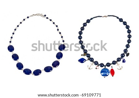 two necklaces with blue beads over white - stock photo
