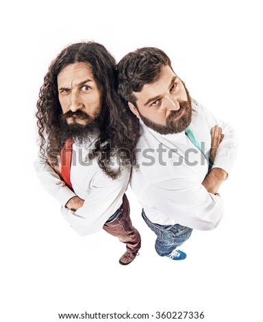 Two nerdy guys looking at the camera - stock photo