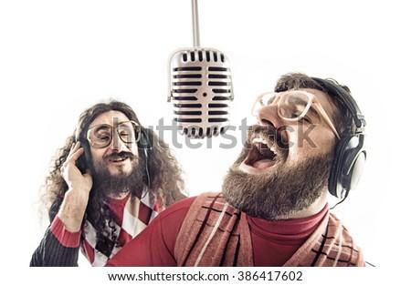 Two nerdy guys singing - stock photo