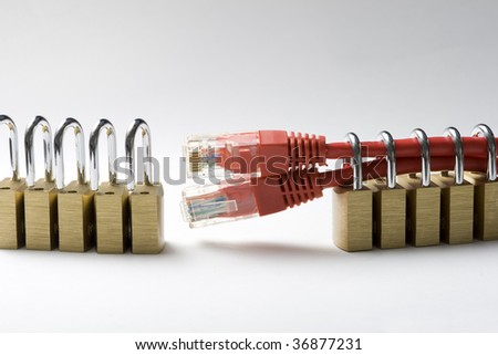 Two network cables secured by a padlock - stock photo