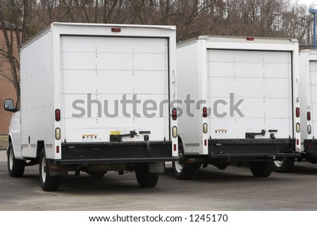 Two New Box Delivery or Moving Trucks - stock photo