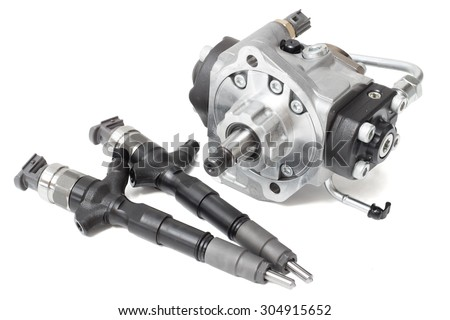 Two new solenoid injectors for diesel fuel lying on a white background with a rod and a fuel injection pump - stock photo