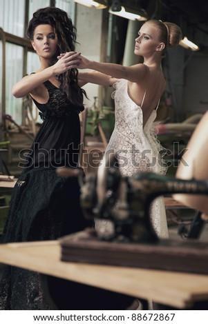 Two nostalgic women dancing - stock photo