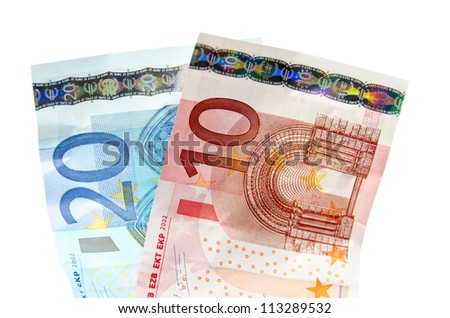 Two notes of 10 and 20 euros on white background - stock photo