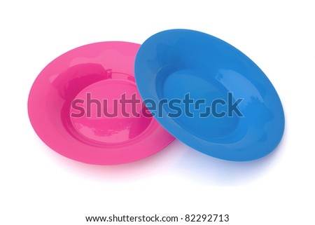 two of fancy plastic dishes on white background.