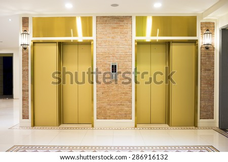Two of luxury elevator in modern building. - stock photo