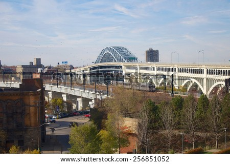 Two of the many bridges in Cleveland. Here, the RTA rail bridge (left) and the Detroit-Superior Bridge (right), looking west. These bridges, among others, connect Downtown to the West Side. - stock photo
