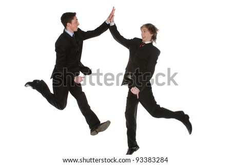 two office manager in a joyous leap