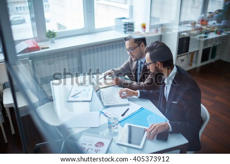 Two office workers discussing business issues together