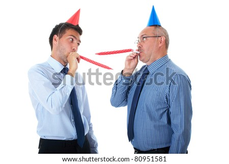 two office workers, junior and senior one wears paper party hats, isolated on white - stock photo